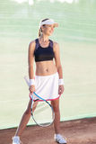 Professional Sportswoman With Tennis Racquet at the Tennis Court Stock Photos