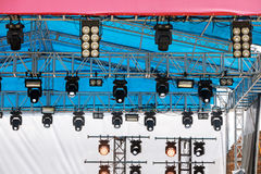 Professional spot light system mounted under roof of outdoor sta Stock Photo