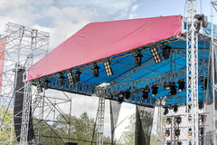 Professional spotlight system mounted on outdoor concert stage Stock Photos