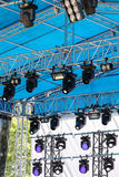 Professional spotlight system of outdoor stage under blue roof Royalty Free Stock Photography