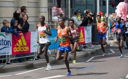Professional sprinter arriving the first in Canary Wharf.. London, UK. London, UK - April 23, 2017: London Marathon. Professional sprinter arriving the first in Stock Photo
