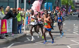 Professional sprinter arriving the first in Canary Wharf.. London, UK. London, UK - April 23, 2017: London Marathon. Professional sprinter arriving the first in Stock Photos