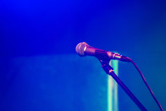 Professional stage microphone on blue. Professional stage microphone over blurred blue background Stock Photography