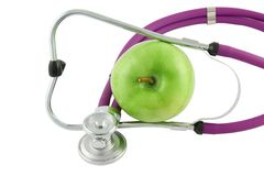 Professional stethoscope and green apple Royalty Free Stock Images