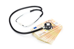 Professional stethoscope lying on stack of euro notes Royalty Free Stock Photos