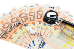 Professional stethoscope on pile of euro bills Royalty Free Stock Images