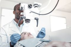 Professional stomatologist using modern equipment during work stock photography