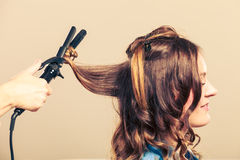Professional straighten hair in salon Royalty Free Stock Images