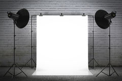Professional strobe lights illuminating a backdrop Royalty Free Stock Photography
