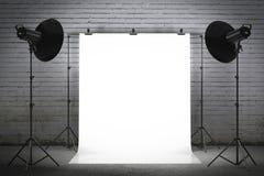 Professional strobe lights illuminating a backdrop Royalty Free Stock Photography