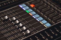 Professional studio equipment for sound mixing. Close-up view of audio control buttons. Media production studio. Music record service royalty free stock photography