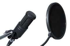 Professional studio microphone. Isolated studio microphone with anti pop filter Stock Photos