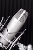 Professional studio microphone. Professional studio silver microphone on black background Royalty Free Stock Image