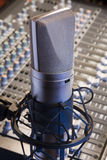 Professional studio microphone. Close up of professional studio microphone and mixing console royalty free stock photography