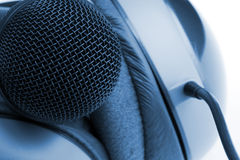 Professional studio microphone and headphones Stock Image