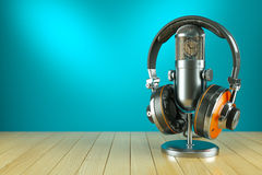 Professional studio microphone and headphones on wooden table. 3d Royalty Free Stock Photo