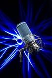 Professional studio microphone. Light brush Royalty Free Stock Photography