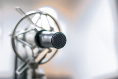 Professional studio microphone for musician. Professional studio microphone over the musician blurred background, Musical instrument Concept Royalty Free Stock Photo