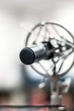 Professional studio microphone for musician. Professional studio microphone over the musician blurred background, Musical instrument Concept Royalty Free Stock Image