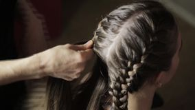 Professional styling makes styling easier, plaiting braids in a beauty salon stock video