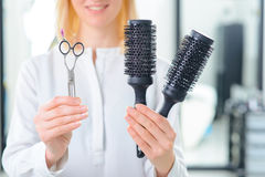 Professional stylist showing various tools Stock Images