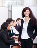 Professional successful business woman in office smiling Royalty Free Stock Photos