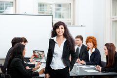 Professional successful business woman in office smiling Stock Photos