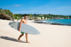 Professional surfer holding a surf board Stock Photography