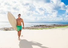 Professional surfer holding a surf board Royalty Free Stock Photo