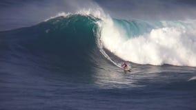Professional surfers ride perform stunts big turquoise blue foam surfing waves splashing in beautiful 4k ocean seascape. Professional surfers ride perform stunts stock video footage