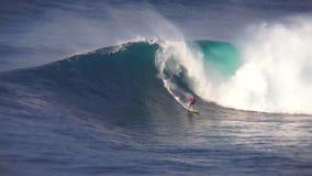 Professional surfers ride perform stunts big turquoise blue foam surfing waves splashing in wonderful 4k ocean seascape. Professional surfers ride perform stunts stock footage
