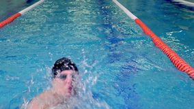 Professional swimmer during training close-up