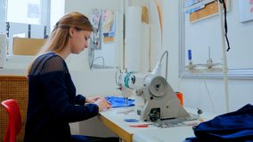 Professional tailor, fashion designer sewing clothes with sewing machine Royalty Free Stock Images