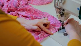 Professional tailor, fashion designer sewing clothes with sewing machine Stock Images