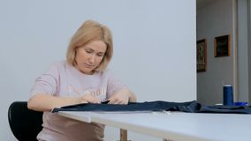 Professional tailor, fashion designer working at sewing studio Stock Images