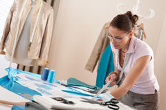 Professional tailor working with fashion sketches Royalty Free Stock Photo