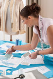 Professional tailor working with fashion sketches Stock Image