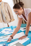 Professional tailor working with fashion sketches Stock Photography