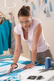 Professional tailor working with fashion sketches Stock Photo