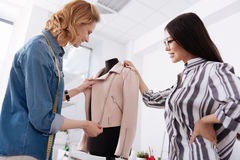 Professional tailors checking out the quality of zips Stock Photos