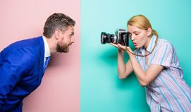 The professional that takes images. girl using professional camera. Fashion shooting in photo studio. Man boss. Posing in front of female photographer royalty free stock photos