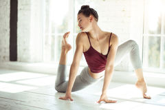 Professional talented dancer exercising in a dance hall Stock Photos