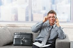 Professional talking on phone smiling Stock Photos