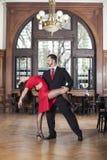 Professional Tango Dancers Performing In Restaurant. Full length of professional tango dancers performing in restaurant Royalty Free Stock Photos