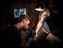Professional tattoo artist Stock Image
