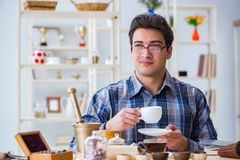 The professional tea expert trying new brews. Professional tea expert trying new brews Stock Images