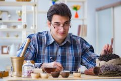 The professional tea expert trying new brews. Professional tea expert trying new brews Royalty Free Stock Images