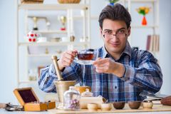 The professional tea expert trying new brews. Professional tea expert trying new brews Stock Photography