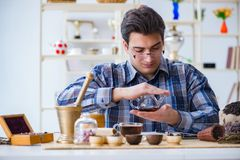 The professional tea expert trying new brews. Professional tea expert trying new brews Stock Photos