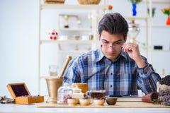 The professional tea expert trying new brews. Professional tea expert trying new brews Royalty Free Stock Photos